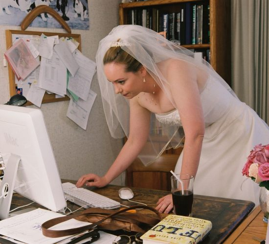 bride-checking-wedding-planning-websites-by-madprime1